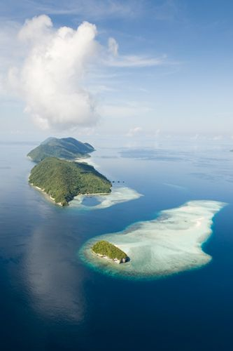 29 Places You HAVE To Visit In 2014 #refinery29  http://www.refinery29.com/61462#slide24  Raja Ampat Islands, Indonesia  Looking for someplace seriously far-flung? Beyond remote? We've got it. Just fly to Jakarta (approximately 23 hours from NYC with one stop in Abu Dhabi). Get a four-hour flight to Sorong. Then, hop on a two-hour boat ride to Kri Island, one of 1,500 small islands, cays, and landforms scattered around the four main Raja Ampat islands. Hellish trip? Yes — but so worth it…