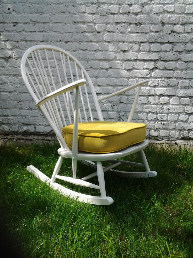 Original Ercol rocking chair - painted white and with the pillow upholstered in sunny yellow.