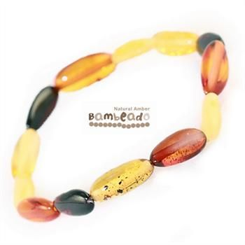 Wearing this amber bracelet might help you with eczema, arthritis or general aches and pains.This 18cm Bambeado amber adult Mixed bean bracelet is made from large bean shaped amber pieces that have been polished so that there are no sharp edges. The amber beads bracelets are mounted on a strong elastic thread and are gorgeous on. While Bambeado amber comes in several colours, the colour is just a matter of personal choice.