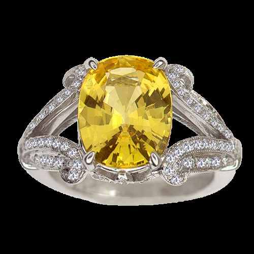18kt. white gold Rita Fusaro ring with yellow oval sapphire and round diamonds..