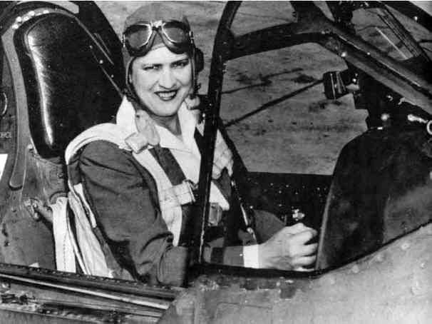 """When WW2 began in Europe, Jacqueline """"Jackie"""" Cochran was a part of """"Wings for Britain"""" that delivered American built aircraft to Britain. In 1939, she became the first woman to fly a bomber, a Hudson V bomber made by Lockheed, across the Atlantic Ocean. Here, Cochran is pictured in the cockpit of a P-40 Warhawk fighter, circa 1942-1945."""