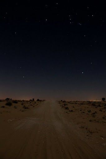 Dirt road at night.