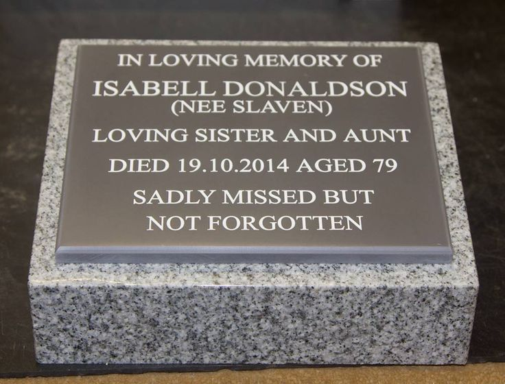 Small Lawn Memorials - The small granite wedge has become very popular. it can be used in the grass, in a garden or under a tree. Not just for people either - these are often bought for beloved pets. This one has an engraved corian memorial plaque attached. http://www.sign-maker.net/memorial/engraved-corian.html