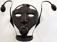"""A scold's bridle, sometimes called """"the branks"""", as well as """"brank's bridle"""" was a punishment device used primarily on women, as a form of torture and public humiliation.[1] It was an iron muzzle in an iron framework that enclosed the head. The bridle-bit (or curb-plate) was about 2 inches long and 1 inch broad, projected into the mouth and pressed down on top of the tongue. [2]The """"curb-plate"""" was frequently studded with spikes, so that if the tongue moved, it inflicted pain a"""