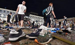 Juventus fans watching the Champions League final stampeded in a Turin piazza in panic after mistaking firecrackers for an explosion or gunshots. Medics treated fans in the square for cuts and other injuries sustained in the chaos and the Italian news agency Ansa reported that around 200 people had been injured.