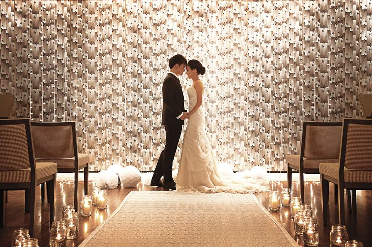 A unique cascading backdrop sets the scene for your fairytale wedding ceremony at Grand Hyatt Singapore.