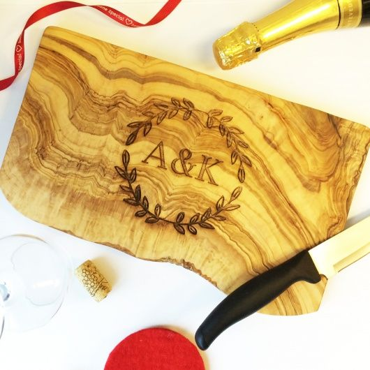 Olive Board Rustic.  This stunning rustic olive chopping board is handmade in Tunisia, it has a beautiful aroma as if you are in the olive grove yourself.    Personalise this olive wood chopping board with any initials of your choice, if you require a personalised message or an alternative design please contact us.