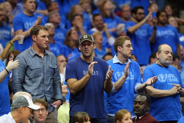 Jason Witten Photos Photos - (L-R)  Jason Witten and Tony Romo of the Dallas Cowboys watch a game between the San Antonio Spurs and the Dallas Mavericks in Game Four of the Western Conference Quarterfinals during the 2014 NBA Playoffs at American Airlines Center on April 28, 2014 in Dallas, Texas. NOTE TO USER: User expressly acknowledges and agrees that, by downloading and or using this photograph, User is consenting to the terms and conditions of the Getty Images License Agreement. - San…