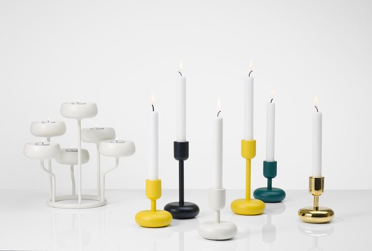 Iittala's Nappula candelabra is part of the evolution of the original Nappula single candleholders designed by Matti Klenell in 2012. Now, both sizes of the single Nappula candle holder are launching in a sunny, bright yellow.