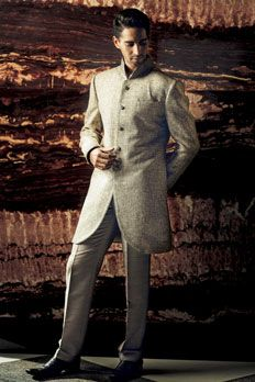 Linen Jute sherwani embellished with resham and stone work on collar.