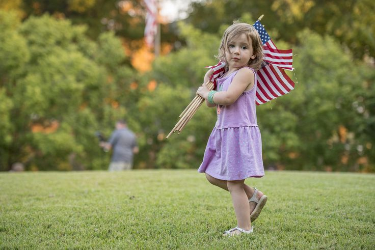 https://flic.kr/p/NRUCtG | Little patriot | Lily Aiken, 2, of Central S.C., helps place American flags around Clemson Universityâs Scroll of Honor as part of a tradition for the schoolâs Military Appreiciation Day, Nov. 3, 2016. (Photo by Ken Scar)