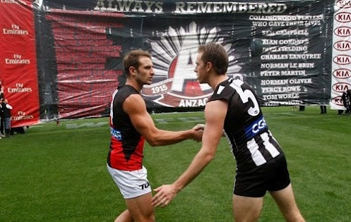 AFL 2012 Rd 05 - Collingwood v Essendon    Collingwood captain Nick Maxwell and Essendon captain Jobe Watson shake hands before their teams run through a joint banner for the AFL Round 05 ANZAC Day match between the Collingwood Magpies and the Essendon Bombers at the MCG, Melbourne. (Photo: Lachlan Cunningham/AFL Photos) AFL Media — at Melbourne Cricket Ground (MCG).