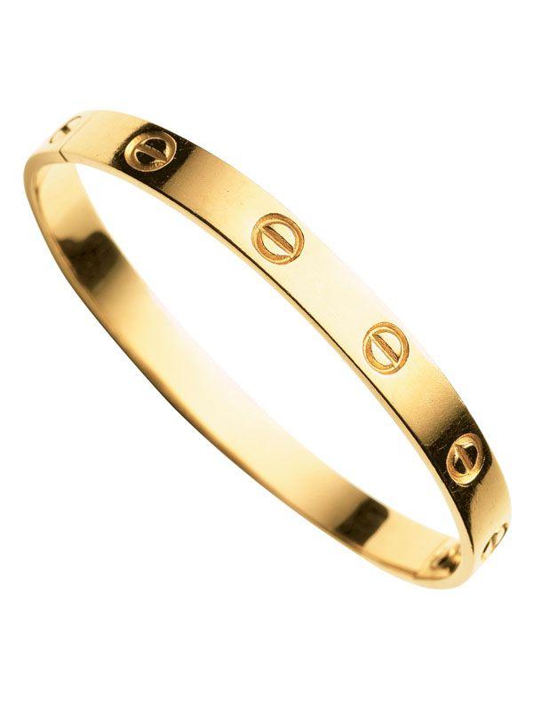 Cartier Love bangle, $5575, cartier.us.   - HarpersBAZAAR.com