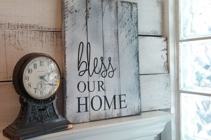 Perfect rustic 'Bless Our Home' sign. Beautifully distressed wood is hand painted in white and distressed. The letters are hand painted in black for the simple rustic charm. Fixer Upper inspired. Comes ready to hang with saw tooth hanger measures approx: 16 X 11  Our signs are all handmade