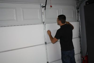 DIY garage door insulation- keeps house warm during winter and cool during summer..  Hubby needs this