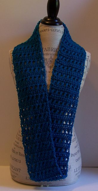 The crossed double crochet is one of my favorite stitches and this infinity scarf has lots of them. Infinity Scarves are the trendy new look and this scarf has the right amount of lace style without sacrificing warmth. Wear it doubled in the cooler weather and single to ward off a chilly office or cool interior, or just to add a fashionable pop of color and style to your wardrobe.