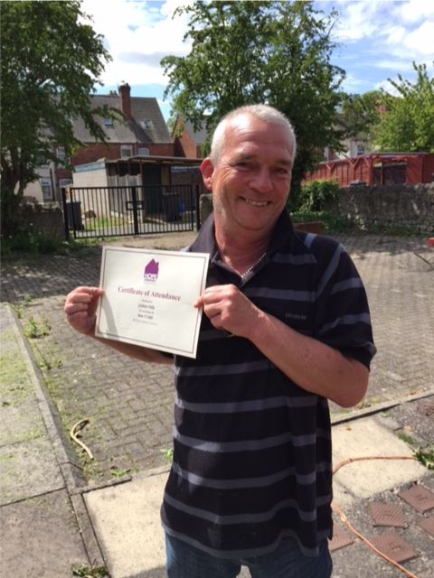 Graham receiving his certificate for I.T training!