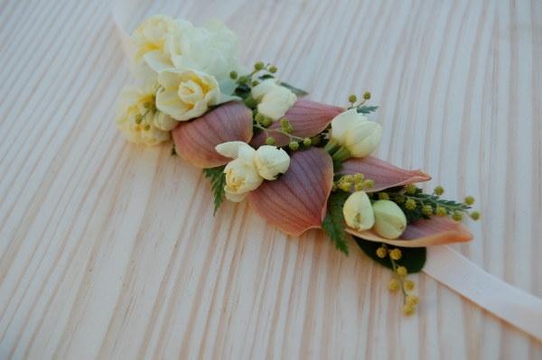 Headband sewn of cymbidium orchid petals, acacia, narcissus, rabbit foot fern, and daphne blossoms.