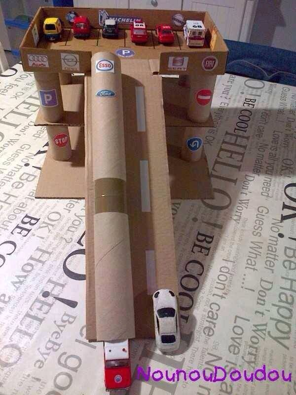 DIY cardboard garage toy to make for boys from box and cardboard tubes.