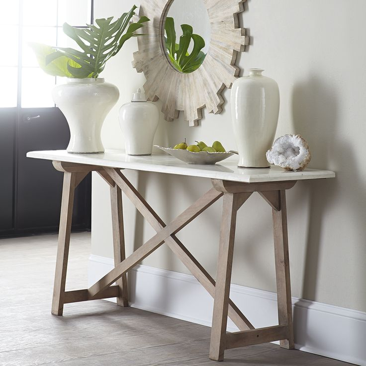 Beautiful marble and mango wood deliver simple sophistication to a space with our Marble-Top Console Table.