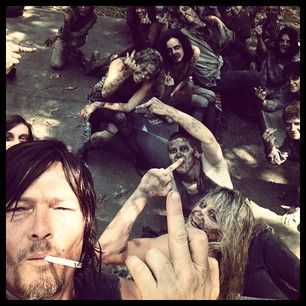 Giving us the middle finger. | 36 Photos Of Norman Reedus That Will Give You A Zombie Boner