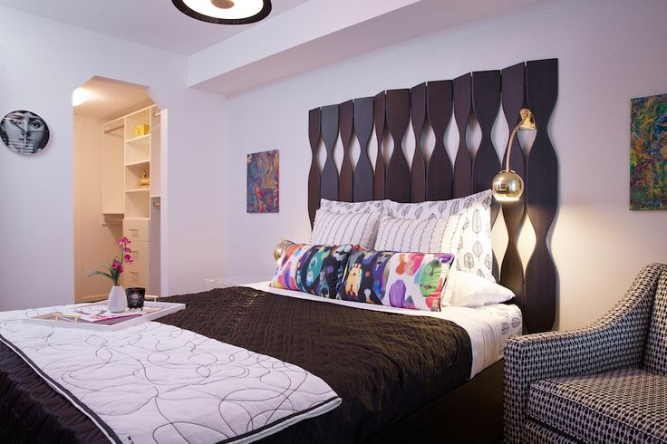 """A visit to the Andy Warhol museum in Pittsburgh last fall was the designer's starting point for this one-bedroom Pop Art inspired unit. Black and white furnishings are paired with vibrant coloured accessories and gold metal accents that will surely appeal to the savvy fashion-forward crowd.   (Built by Brad Remington Homes; Interior Design by ANA Interiors; Photography by Photophilcro). Find this at Copperfield Park III in the """"B2 Showsuite""""."""