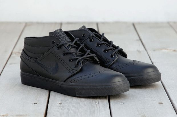 """Stefan Janoski's signature shoe, the SB Zoom Stefan Janoski, has received a formal makeover for the winter months. The mid-cut """"Black Brogue"""" colorway features wingtip and brogue detailing throughout the black leather upper including the toecap and side panels."""