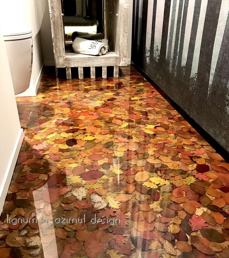 azimut resine, pavimento realizzato con foglie naturali autunnali in resina trasparente per la show room Dada's home in Crans, serie naturale lignum by Azimut design Montana.