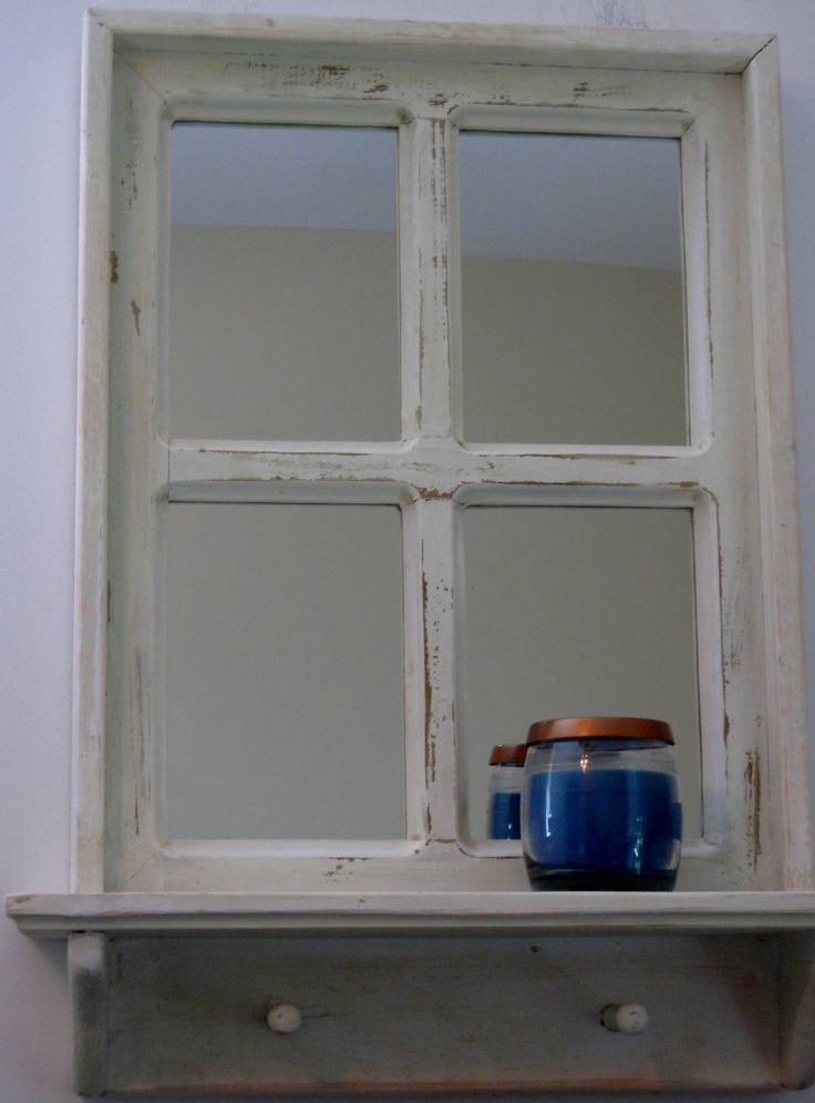 this x hand crafted wood window frame has been painted white then distressed mirrors have been attached to the backside of each pane