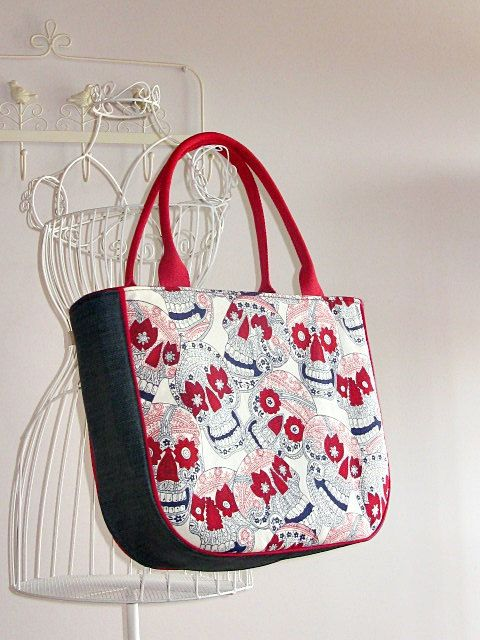 Check out this item in my Etsy shop https://www.etsy.com/listing/190384148/day-of-the-dead-skulls-tote-bag-large