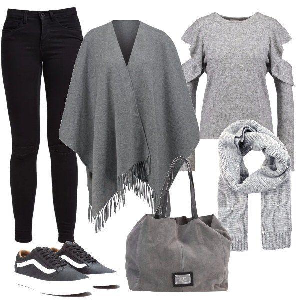 Look adatto a tutti i giorni o per una giornata all'università con comodità. Jeans skinny fit neri, maglione grigio con oblò sulle maniche, mantella e sciarpa con pois bianchi. Sneakers basse nere e shopping bag.