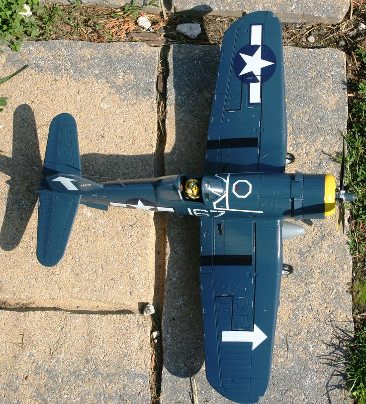 Top view of the Corsair showing the arrow markings which indicate the plane was part of the USS Bunker Hill's air group.