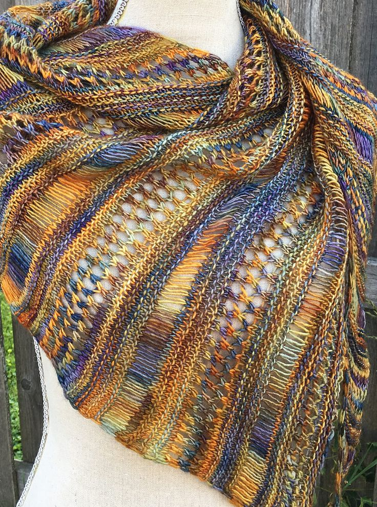 Free Knitting Pattern for One Skein Stormy Sky Shawl - Perfect for that one skein of special yarn! This asymmetrical shawl alternates sections of dropped stitches, eyelet lace, and garter stitch to showcase multi-colored yarn in skewed triangle. Easy to memorize. Designed by Life Is Cozy.Pictured projectby River Poet who used one skein of Malabrigo yarn (420 yards) for the project.