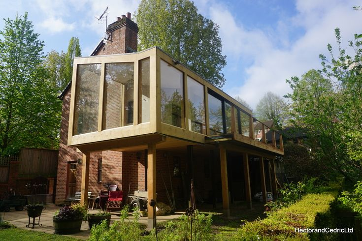 A raised fully glazed timber framed sun-room in Oak and Douglas Fir, which is connected to a veranda extension/adaption with a large sliding door opening onto a veranda and staircase to the garden below. This sun room adds a large bright living space to the property. This building is a great way to extend a property in Sheffield for those of you who have gardens lower than the ground floor, as often is the case in hilly Sheffield. Supporting an extension on a traditional timber frame…