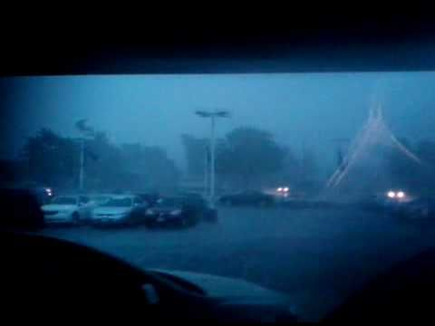 Chicago Tornado 2010 - Bunch of guys in a garage get the crap scared out of them multiple times as lightning strikes close.