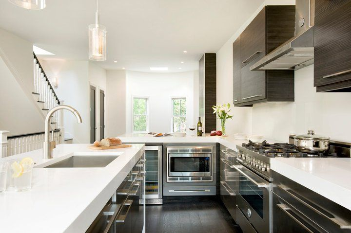 Fantastic sleek modern kitchen design with European kitchen cabinets, white quartz counter tops, ...