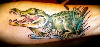 Alligator tattoo.