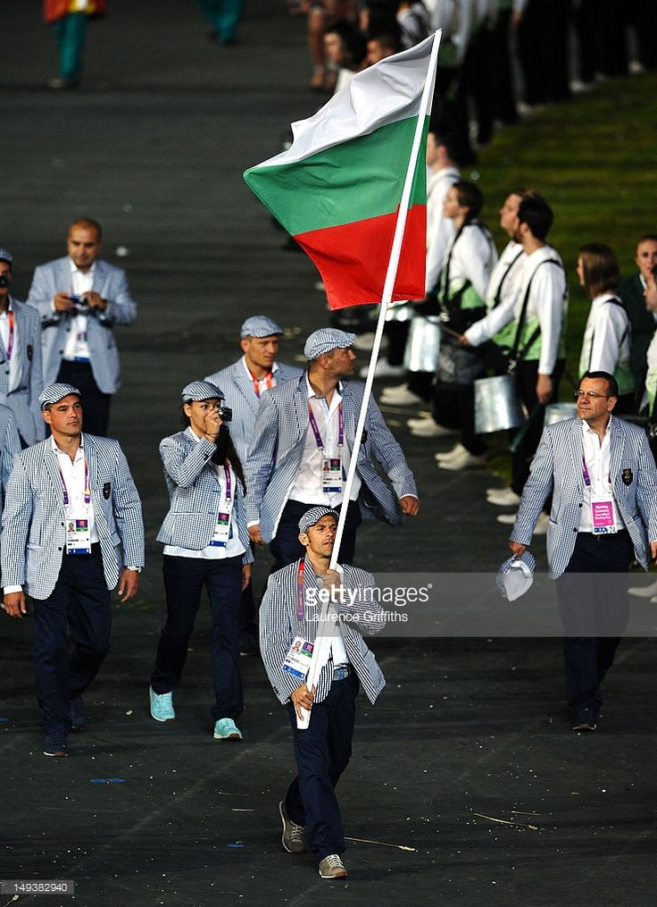 Iordan Iovtchev of the Bulgaria Olympic gymnastics team carries his country's flag during the Opening Ceremony of the London 2012 Olympic Games at the Olympic Stadium on July 27, 2012 in London, England.