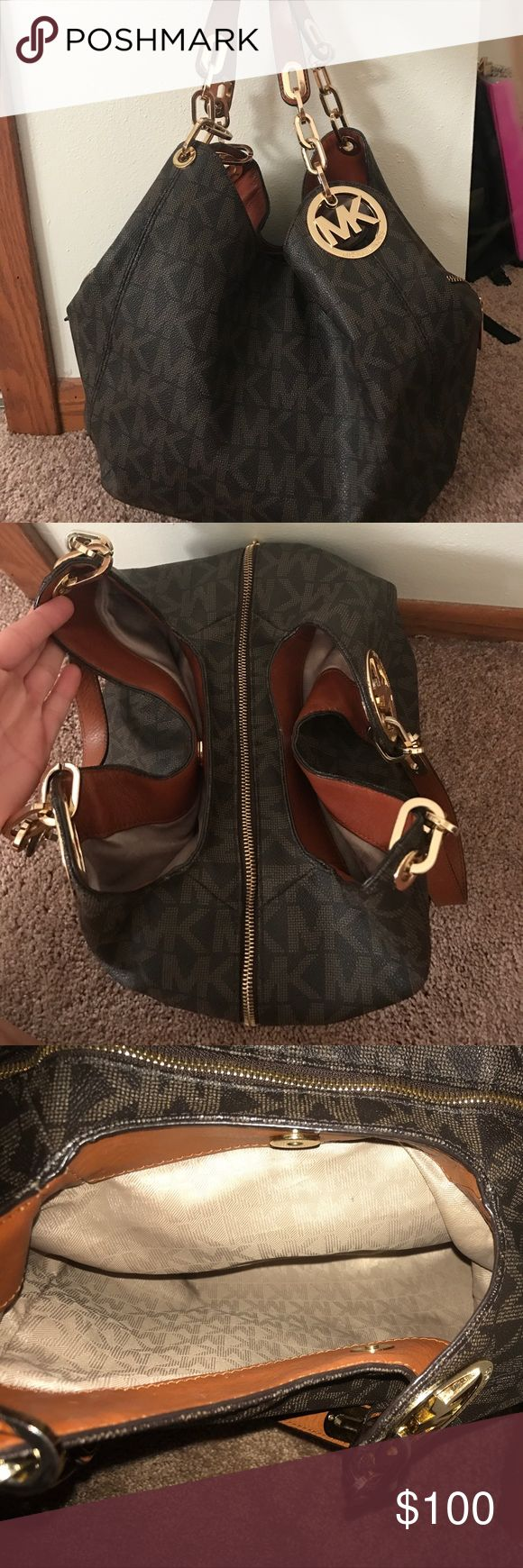 Brown Michael Kors purse Medium brown and cream MK purse. Bought last year, in good condition. Multiple pockets and easy to carry. Really good purse. Michael Kors Bags Shoulder Bags