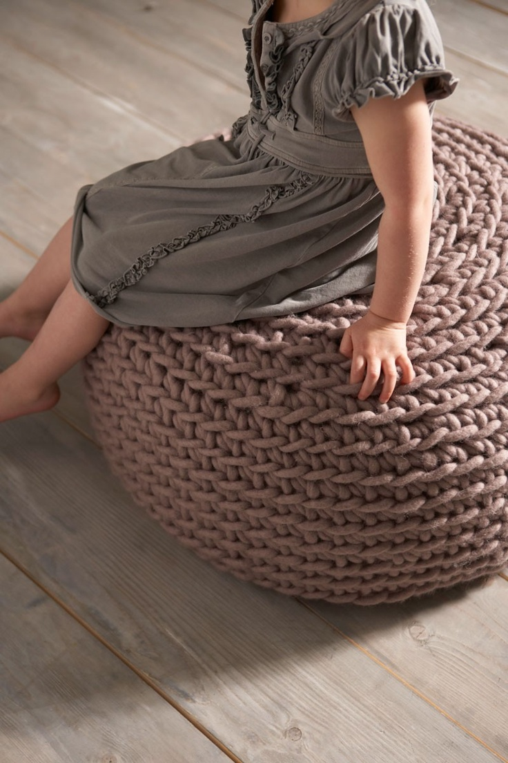 Crocheted bean bag cover.  Much prettier and is washable.  Make a bean bag look like an expensive poof.
