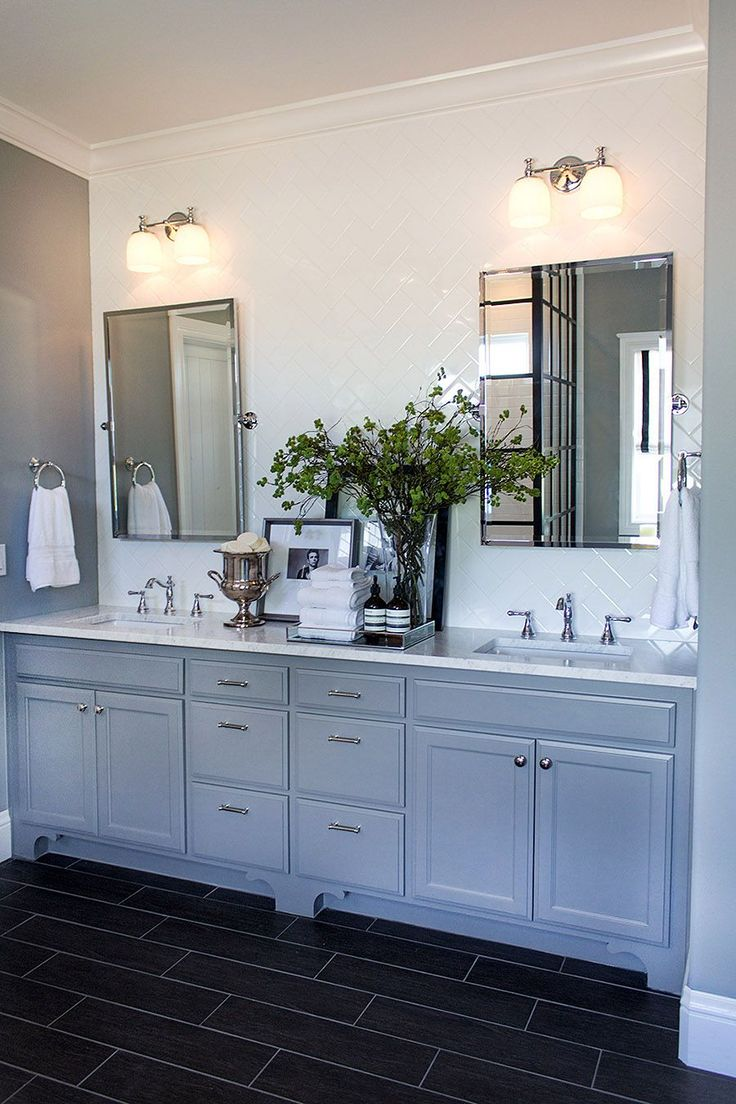 From the PB Blog- I decided to create a subway tiled accent wall, in a herringbone pattern, above the vanity. Pottery Barn's Kensington Pivot Mirrors, Mercer Double Sconce and Towel Ring complete the look, taking my Hollywood vision to the next level.