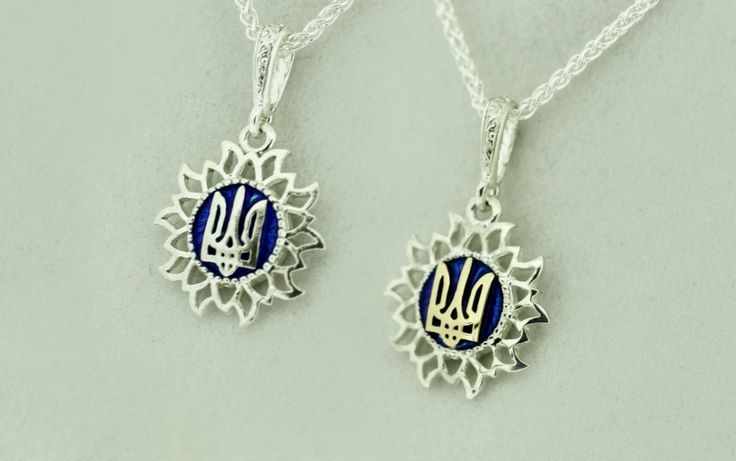 Some nature-inspired beauty to show off your Ukrainian heritage. This .925 sterling silver pendant features a beautiful sunflower design with a tryzub.