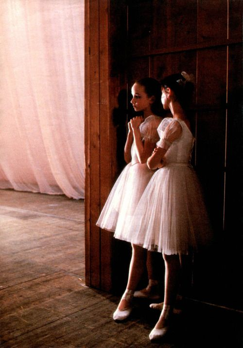 I love the softness and innocence of this picture, as well as the contemplative and focused look of the ballerinas as they gaze out to the stage, probably anticipating for their part in the dance.