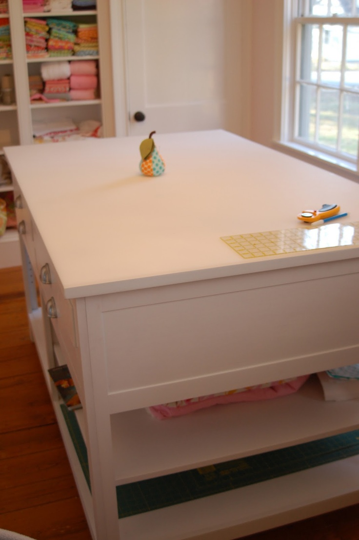 awesome cutting table with tons of storage underneath for large items
