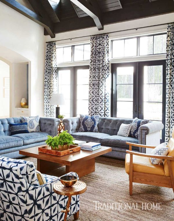 A Japanese-inspired, indigo-hue fabric used in draperies and as upholstery on a club chair is the starring print in the family room. - Photo: David A. Land / Design: Andrew Howard