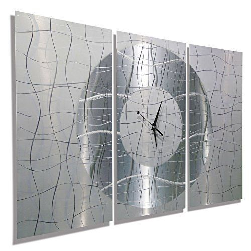 Unique large wall clocks are an easy way to bring life to a boring space.  In fact large modern wall clocks are extremely popular right now as not only do they look timeless but also serve as large decorative wall art!    Jon Allen Metal Art - Statements2000 38-Inch-by-24-Inch Metal Wall Clock, Silver and White