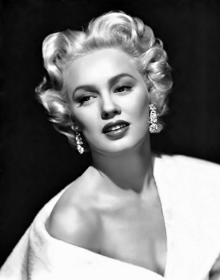 Mamie Van Doren - (1931-  ) born Joan Lucille Olander.  Film actress, model, singer, pin up girl and sex symbol.