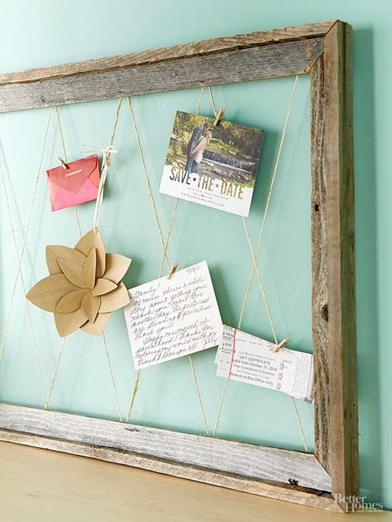 This rustic-chic display will be Pinterest-worthy when you're finished: Start with a wood frame from a flea market or antiques store. Hammer short nails into the back at even intervals, and string twine between them. Use small clothespins from a crafts store to secure invitations, tickets, snapshots, notes, and more. /