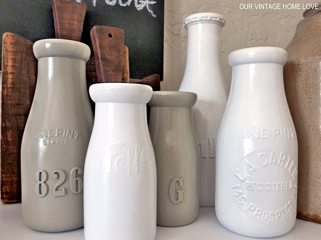 DIY - Old glass bottles with ADDED FOAM STICKERS before being Primed with Valspar White Primer then painted with Valspar White Spray Paint then a clear glossy sealer. These look fantastic.