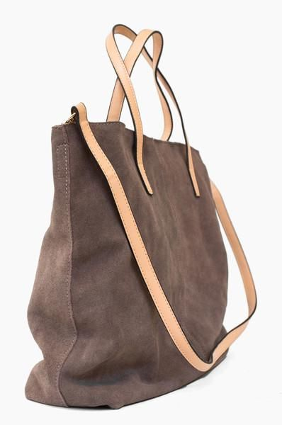 The Belltown Tote - Inspired by the store's new neighborhood, this bag is sleek and stylish with a few unexpected elements - it's fully reversible from suede leather to canvas!